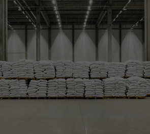 Warehouse With Bags Of Rice, Groats, And Flour On Pallets Prepared For Shipping